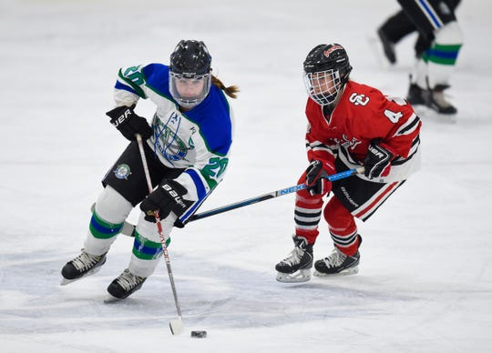 Brooke Walters skates with the puck for Sartell/Sauk Rapids during the Thursday, Jan. 31, game against St. Cloud at Bernicks Arena in Sartell.