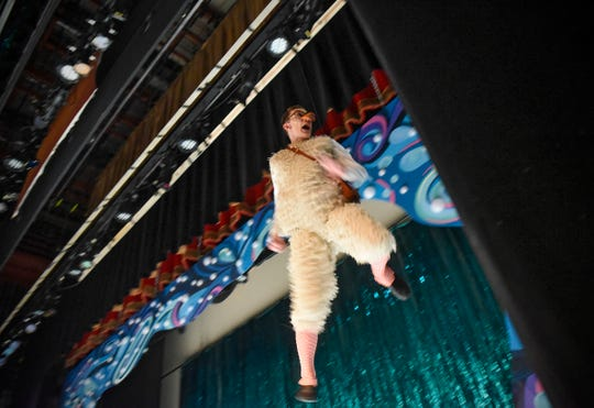 """Dylan Pringle flies high above the stage in his part as Scuttle during a rehearsal Thursday, Jan. 31, for the GREAT Theatre production of Disney's """"The Little Mermaid"""" at the Paramount Theatre in St. Cloud."""