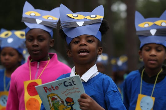 "First grader Chanel Fuller walks with her class dressed to represent the book ""Pete the Cat"" during the Oak Ridge Elementary School literacy parade Friday, Feb. 1, 2019. The parade celebrated the end of Literacy Week in Leon County Schools."