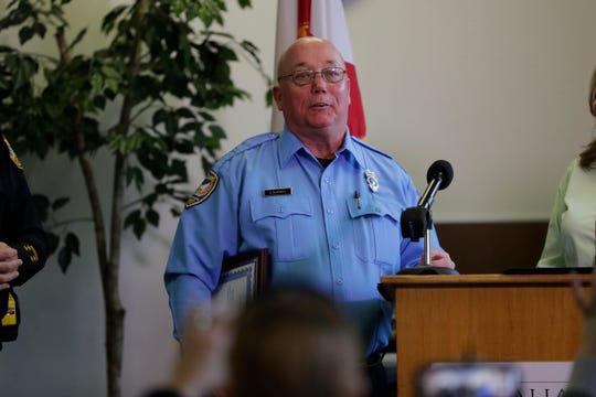 Danny Burnett gives a short acceptance speech after receiving the award for Crossing Guard of the Year at the Tallahassee Police Department, Friday, Feb. 1, 2019.