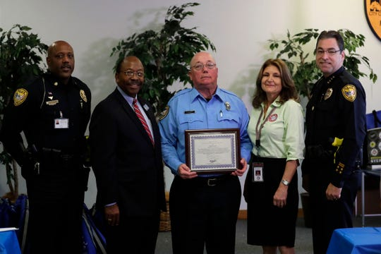 Major Rod Young, left, Commissioner Curtis Richardson, Danny Burnett, School Crossing Guard of the Year recipient, Dana Crosby, who works with the School Crossing Guard Training Program, and Chief Michael DeLeo pose for a photo at the celebration for the Tallahassee crossing guards, Friday, Feb. 1, 2019.