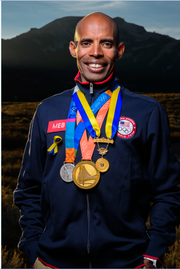 Meb Keflezighi sports his Olympic medals. He'll be running in the half marathon this weekend. This is his first-ever trip to Tallahassee.