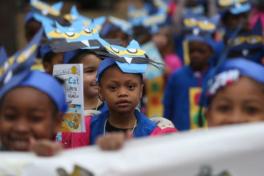"First grader Jayla Footman walks with her classmates, dressed to represent the book ""Pete the Cat"" during the Oak Ridge Elementary School literacy parade Friday, Feb. 1, 2019. The parade celebrated the end of Literacy Week in Leon County Schools."