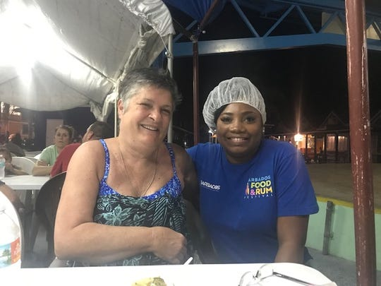 Morgan hanging with our chef at a local restaurant in Barbados.