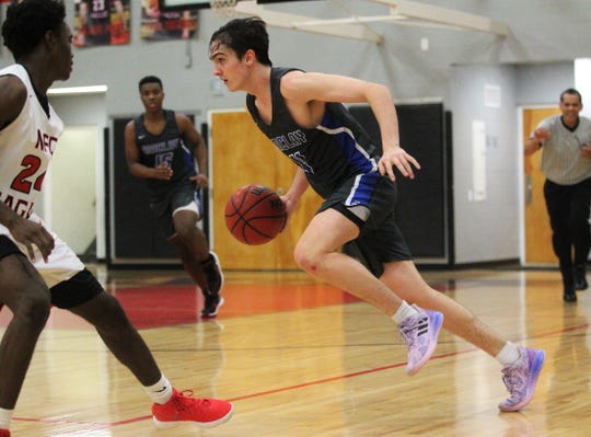 Maclay's Jack Murrah dribbles up court as Maclay beat NFC 62-58 on Jan. 31, 2019.