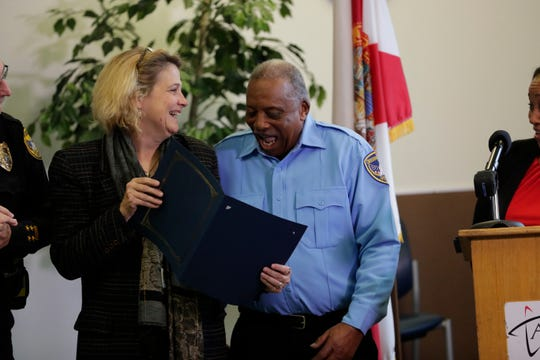 M.R. Street, State Safe Kids of the Big Bend coordinator, presents the award to Robert Austin for being nominated for America's favorite crossing guard at a celebration for the Tallahassee crossing guards, Friday, Feb. 1, 2019.