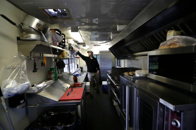 Connor Whitfield,  a Spring Creek Restaurant food truck employee, hangs an order up to be prepared in the Spring Creek Restaurant food truck located in Crawfordville, Fla., Friday, Feb. 1, 2019.
