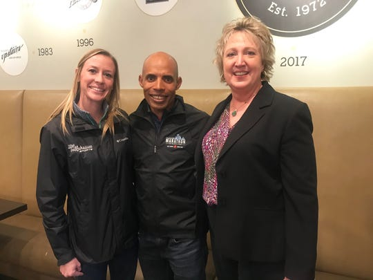Championship runner Meb Keflezighi  poses with director of sports for Leon County tourism Amanda Heidecker (left) and executive director Leon County tourism Kerri Post during a lunch meeting at Andrew's on Friday, Feb. 1. Keflezighi is in town for the Tallahassee Marathon.