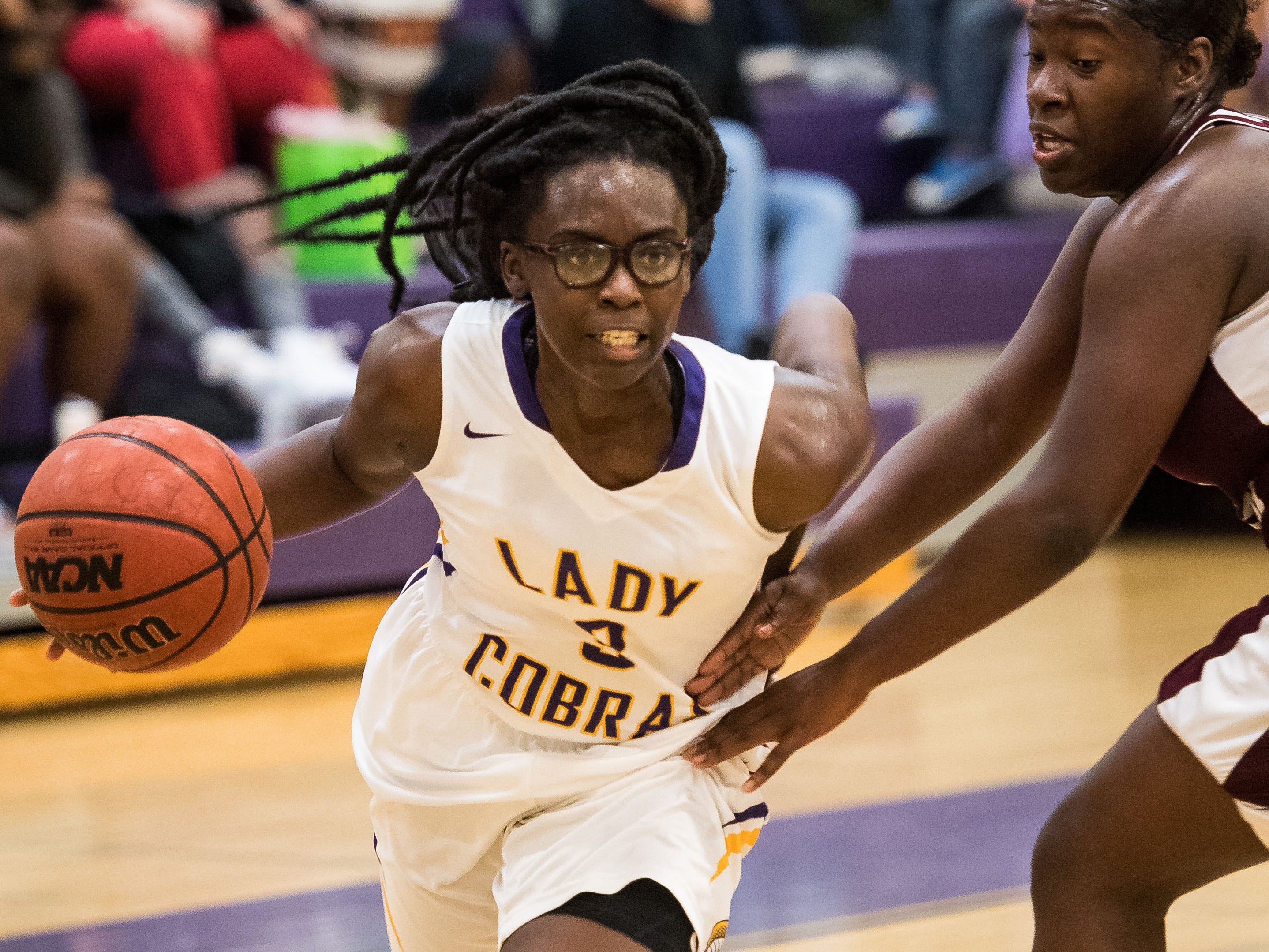 Fort Pierce Central's Trinity Michel (left) breaks past Lake Worth's Lovely Janvier to take a shot in the second period during the high school girls basketball game Thursday, Jan. 31, 2019, at Fort Pierce Central High School.