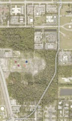 A proposed new route to the 37th Street medical corridor is outlined on this aerial picture furnished by Indian River County. The road would connect to U.S. 1 and Aviation Boulevard, lower left, pass to the east of BigShots golf, center-left, and connect with northbound Dr. Hugh McCrystal Drive, top right,  just west of Cleveland Clinic Indian River Hospital.