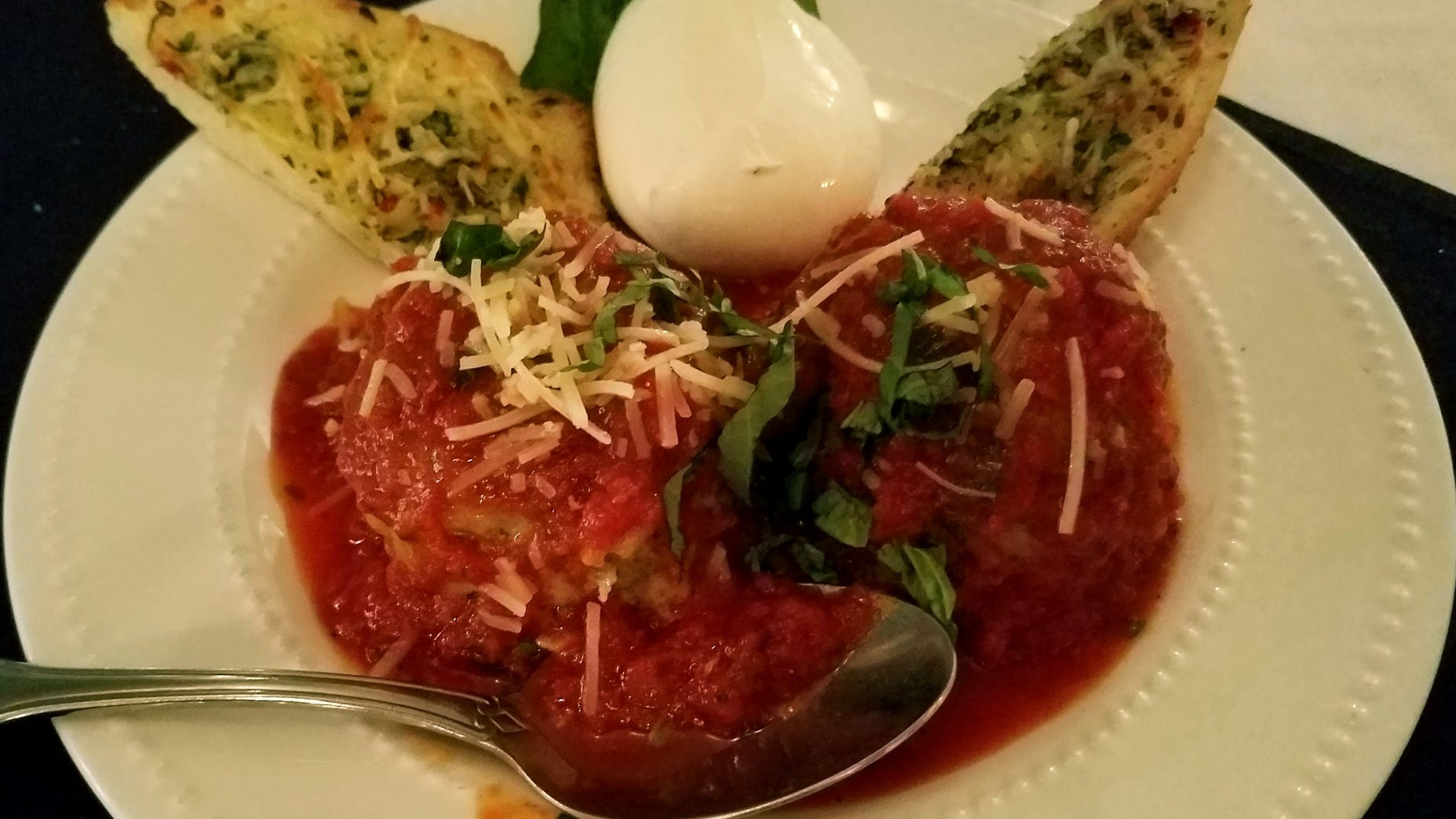 The meatballs and burrata appetizer at 18...