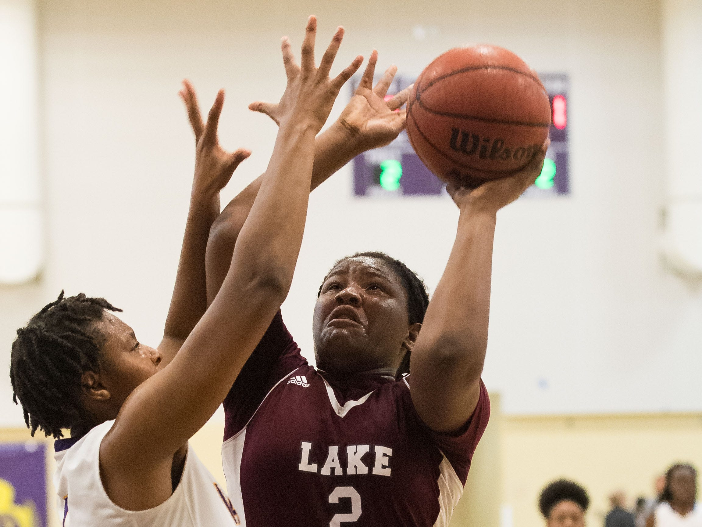 Lake Worth's Monique Joseph (right) tries to shoot over Fort Pierce Central's Amaya Howard during the first period of the high school girls basketball game Thursday, Jan. 31, 2019, at Fort Pierce Central High School.