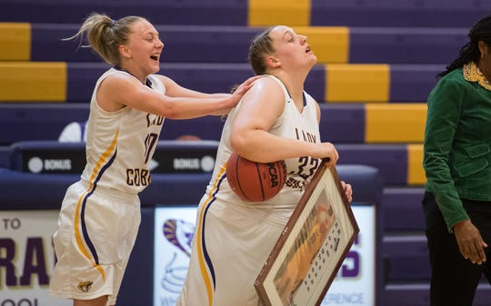 Fort Pierce Central's Maryanne Logsdon (left) congratulates fellow senior Eleighseea Rasmussen after her 500th career rebound against Lake Worth during the first period of the high school girls basketball game Thursday, Jan. 31, 2019, at Fort Pierce Central High School. Logsdon also had a memorable night, scoring her 1,000th point earlier in the game. Head coach Sophia Witherspoon celebrated both girls' achievements during breaks in the game.
