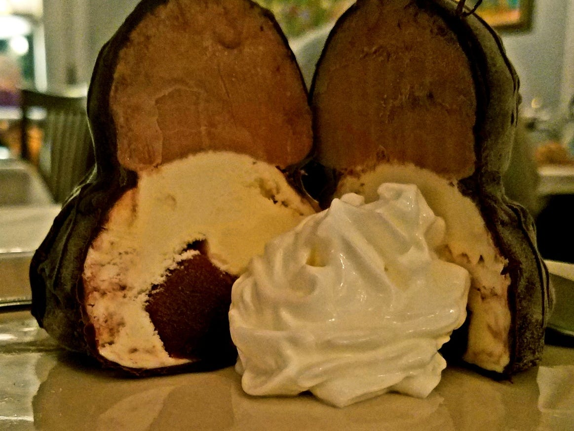 The black-and-white tartuffo at 18 Seminole Street is a raspberry-infused vanilla ice cream with chocolate ice cream and coated in a rich chocolate shell served with a mound of whipped cream.