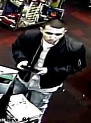 The first suspect was wearing a black bomber-style jacket, a white button-up shirt and light blue denim jeans.