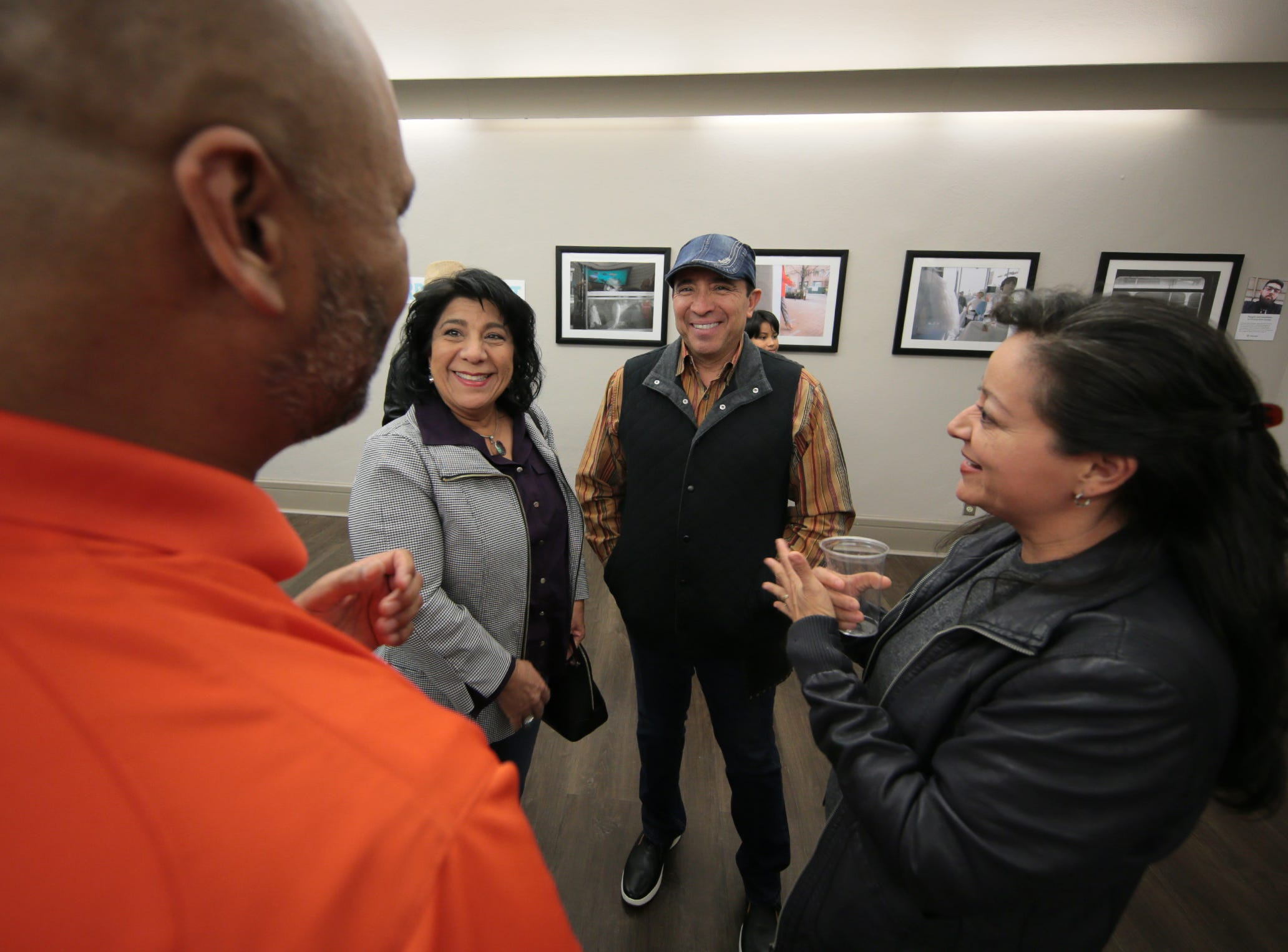"Rudy and Graciella Gutierrez, center, talk with JR and Bobby Hernandez at the opening of ""Rebirth Of Duranguito and Border Street, A Photo Exhibition"" Thursday at UTEP's Centennial Museum."