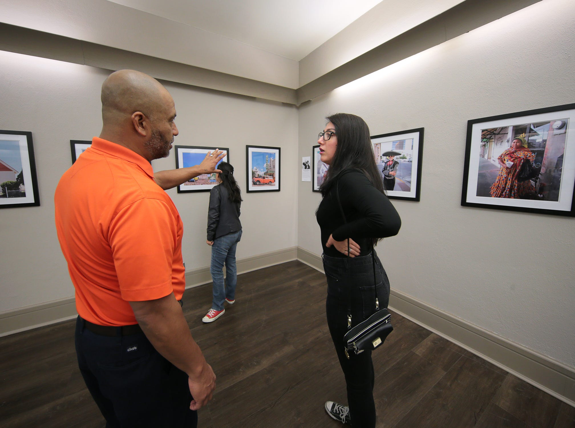 "JR Hernandez helped curate the """"Rebirth Of Duranguito and Border Street, A Photo Exhibition"" which opened Thursday at UTEP's Centennial Museum. Above, Hernandez talks with featured photographer Anais Navarro."