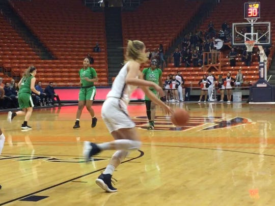 Zuzanna Puc heads up floor during UTEP's game with Marshall Thursday night at the Don Haskins Center
