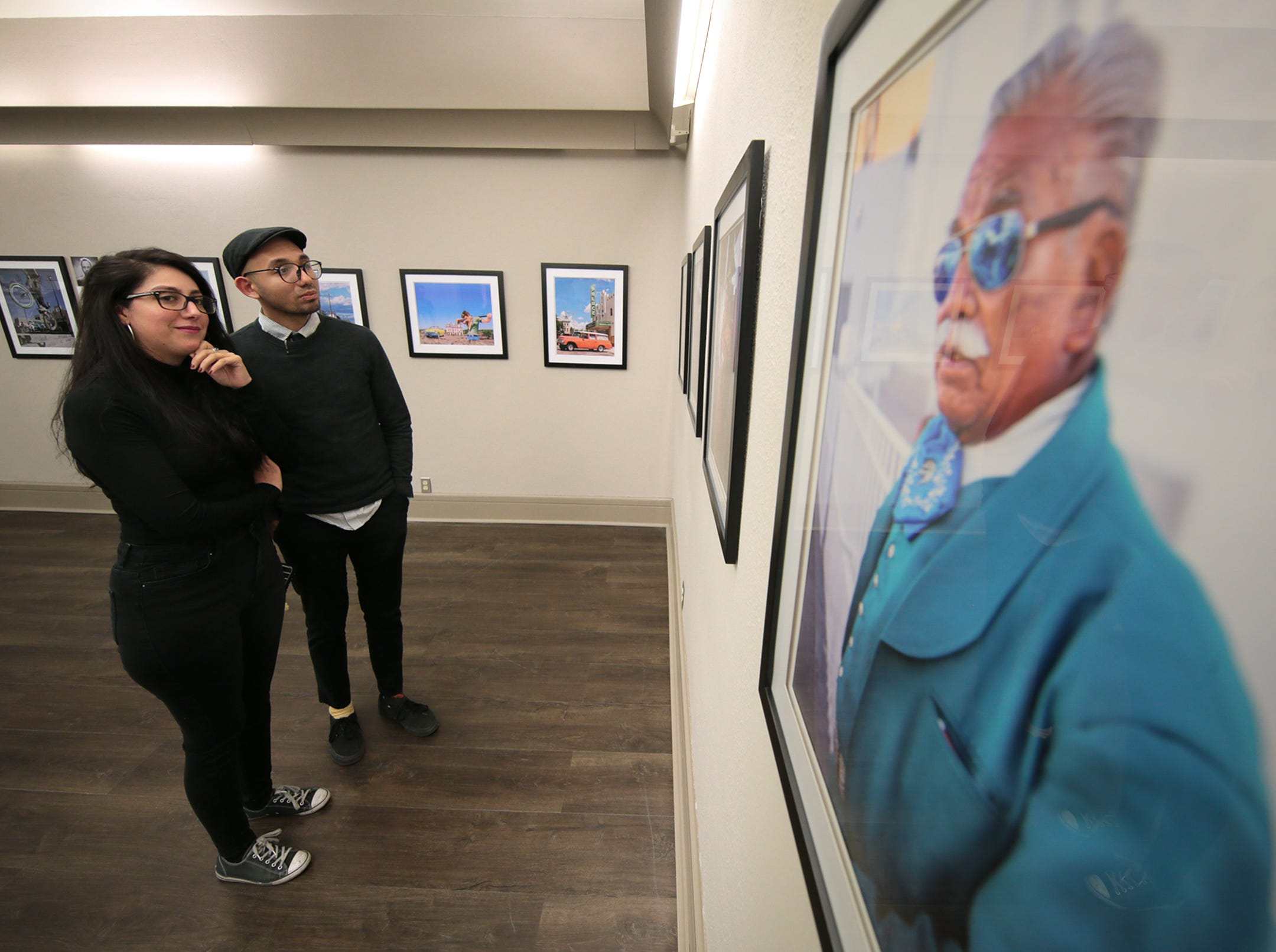 "Street photographer Anais Navarro looks at work by other photographers in the ""Rebirth Of Duranguito and Border Street, A Photo Exhibition"" opening Thursday at UTEP's Centennial Museum."