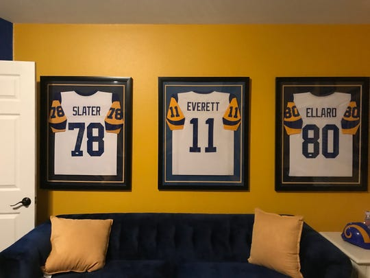 "The framed jerseys of former Rams stars Jackie Slater, Jim Everett and Henry Ellard adorn the ""Rams Room"" of Andre Jeanbart of Westlake Village."