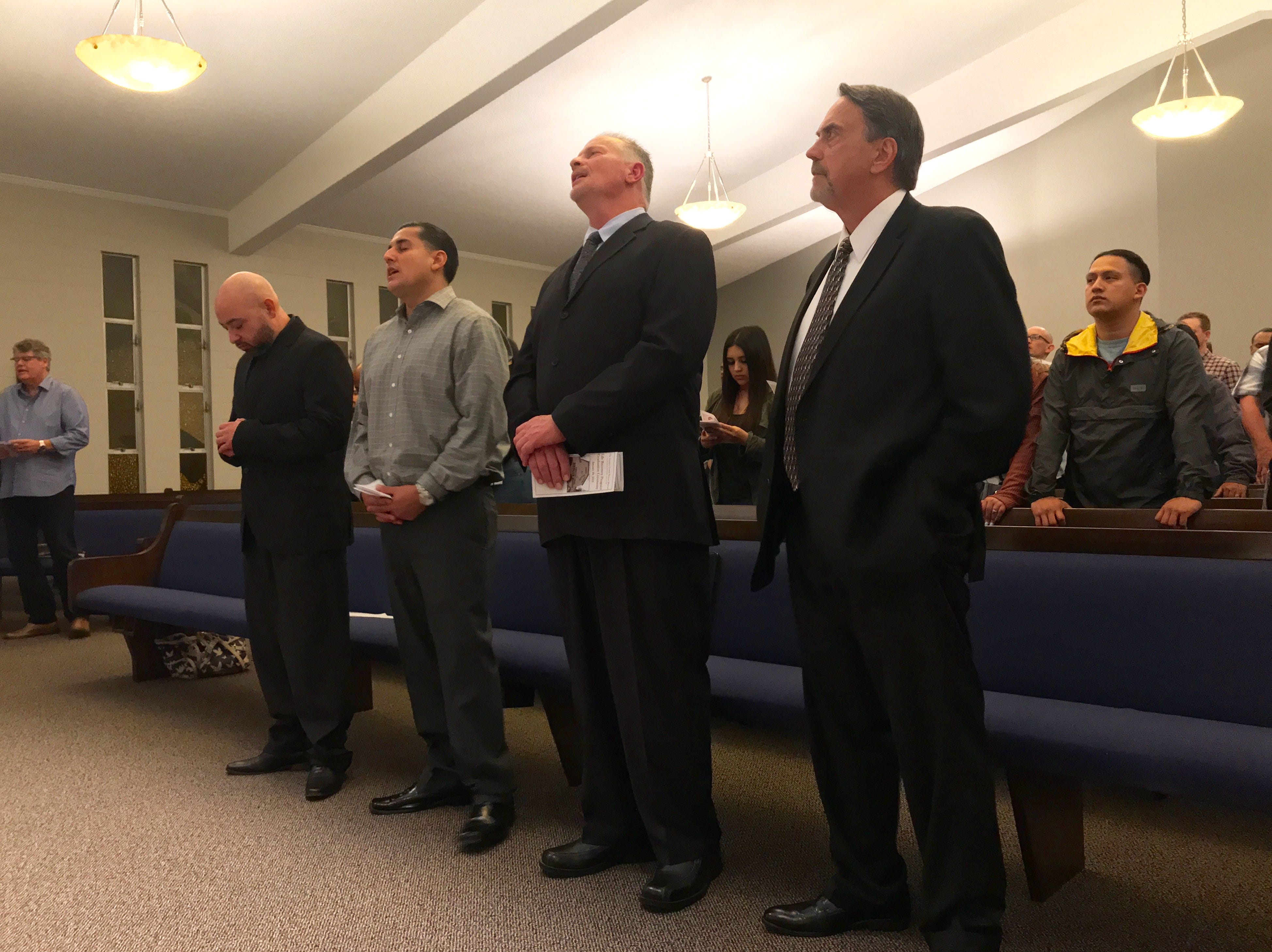 From left to right, Joe Hernandez, JR Gutierrez, Anthony Serres and Casey Finn sing a hymn during their graduation from the 10-month Ventura County Rescue Mission program.