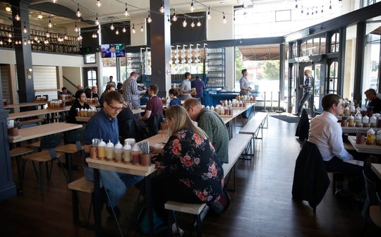 "In this May 9 file photo, customers dine at the Wursthall Restaurant & Bierhaus in San Mateo. Patrons won't be served at the Silicon Valley restaurant if they wear a ""Make America Great Again"" baseball cap ."