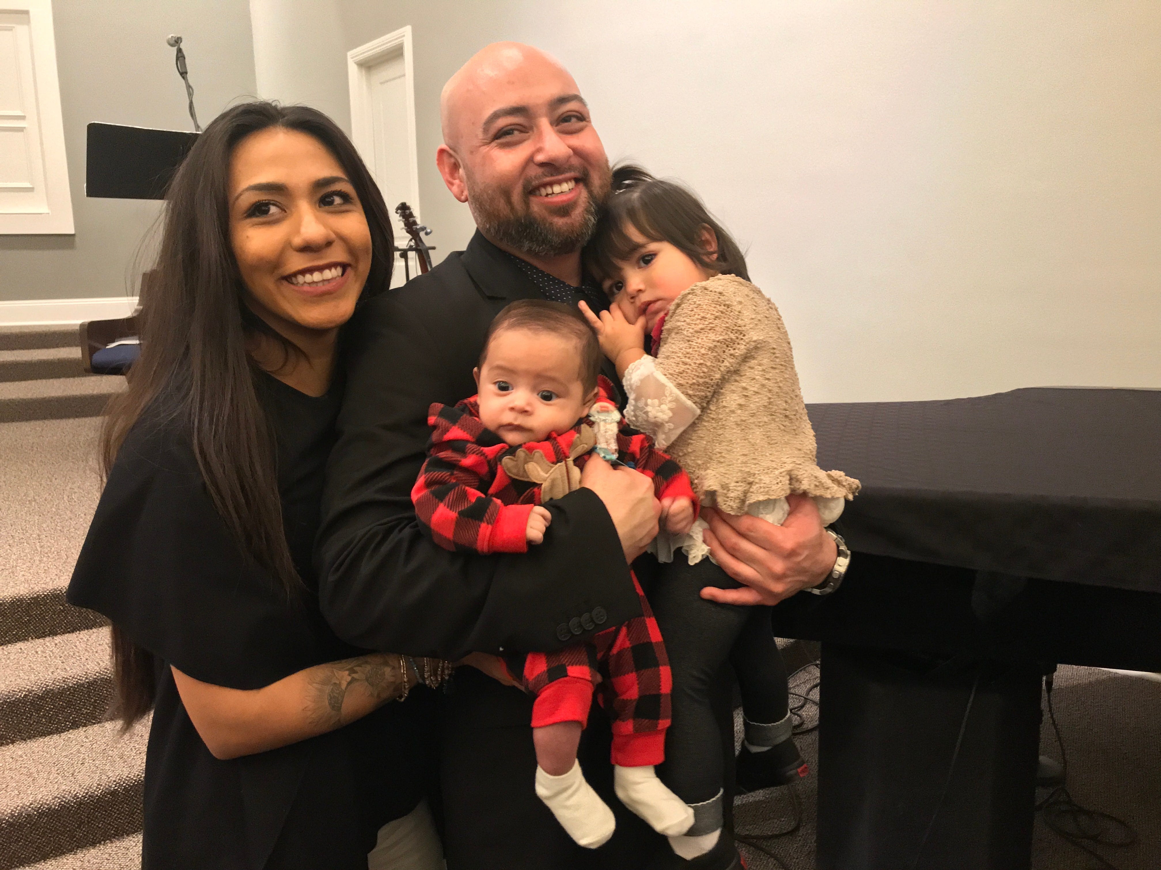 Joe Hernandez poses for photos with his wife, Sarai Hernandez, and two children, Amri and Roman, following his graduation ceremony Jan. 29 at the Ventura County Rescue Mission in Oxnard.