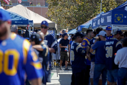 Rams fans assemble outside of the Coliseum before a game this season.