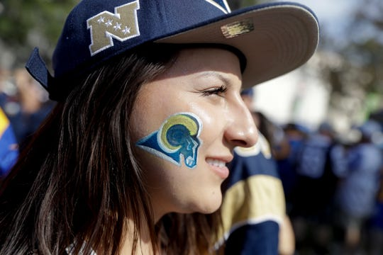 A Rams fan shows her dedication to the team during a home game this season.