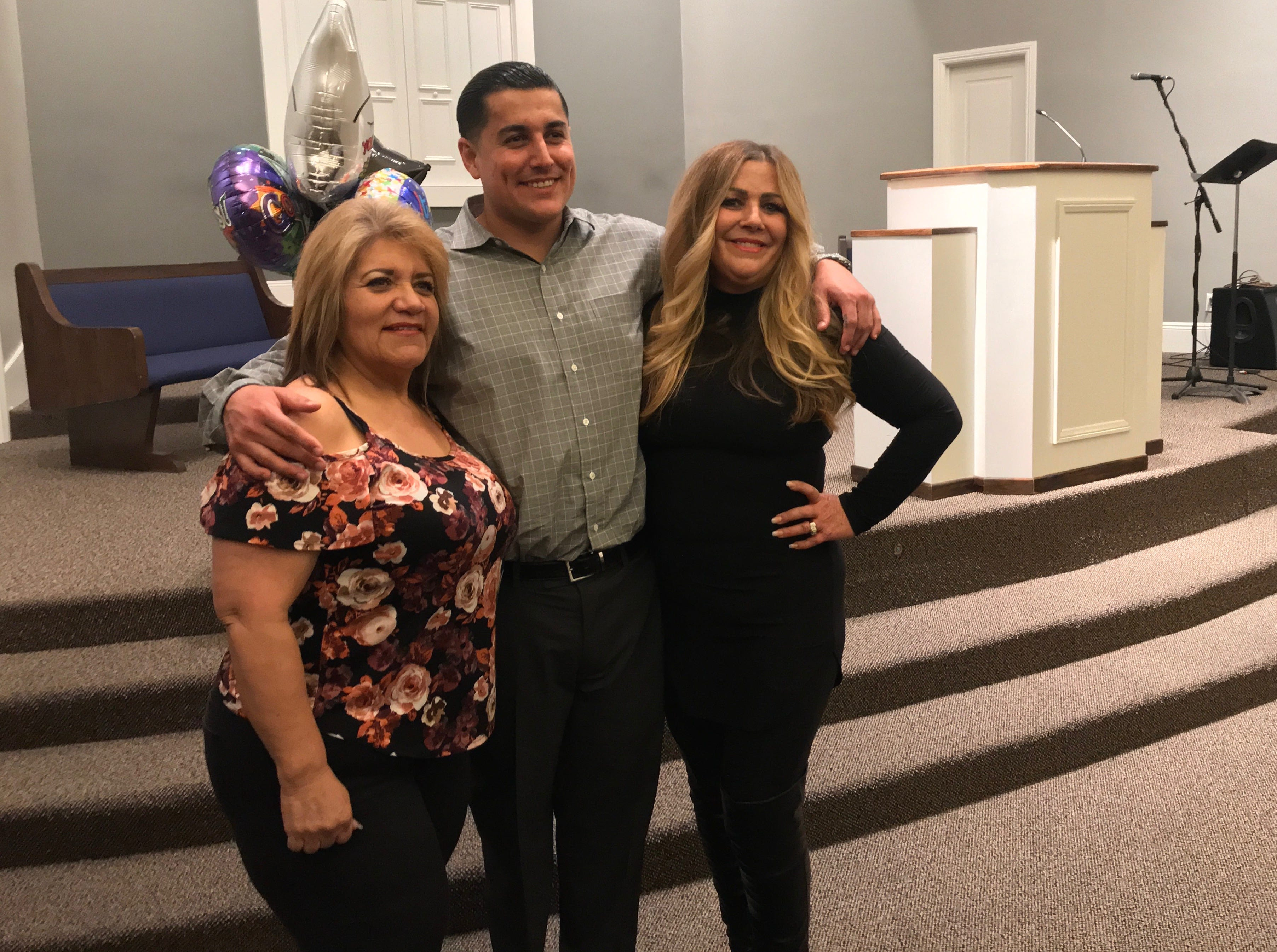 Ventura County Rescue Mission graduate JR Gutierrez poses with his godmother, Darlene Figueroa Murillo, left, and mom, Deborah Balkcom, following his graduation ceremony.