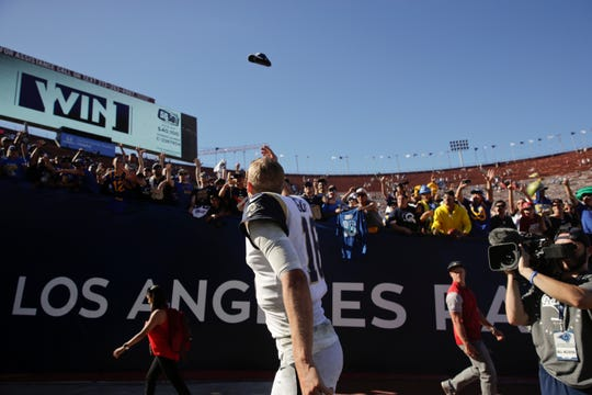 Rams quarterback Jared Goff tosses his hat toward the fans after a home game this season.