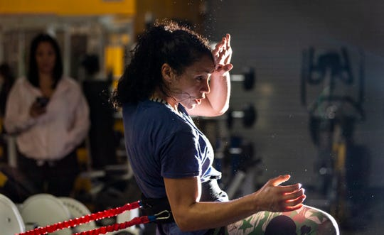Sweat scatters from Visalia resident and UFC fighter Marion Reneau during training on Thursday, January 31, 2019.