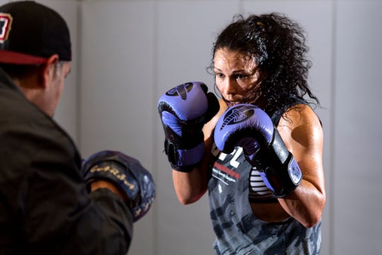 Visalia resident and UFC fighter Marion Reneau trains with boxing coach Eloy Garza on Thursday, January 31, 2019.