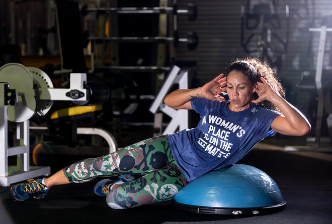 Visalia resident and UFC fighter Marion Reneau trains on Thursday, January 31, 2019.