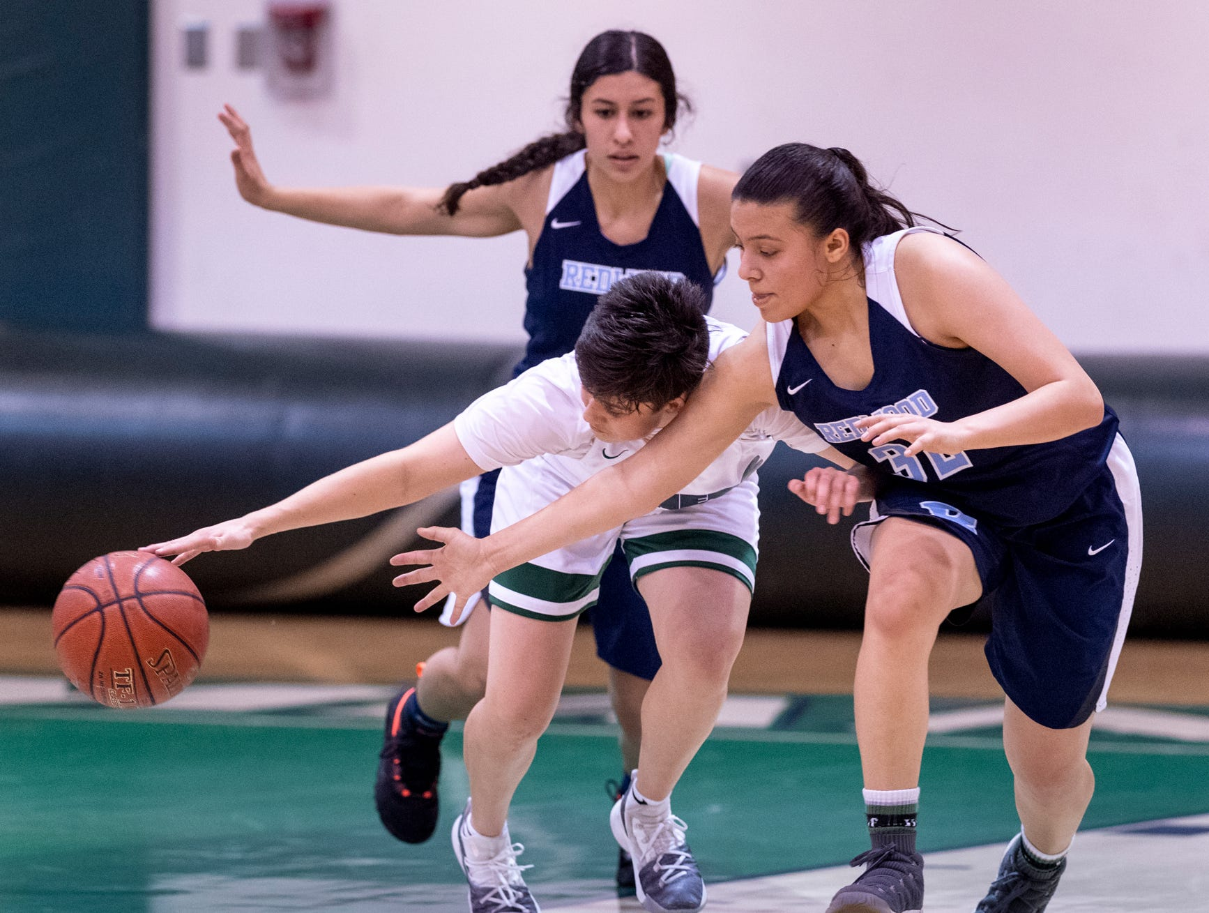 Redwood's Janessa Haro, right, and El Diamante's Lucy Tazio scramble for a loose ball in a girls basketball game on Thursday, January 31, 2019.