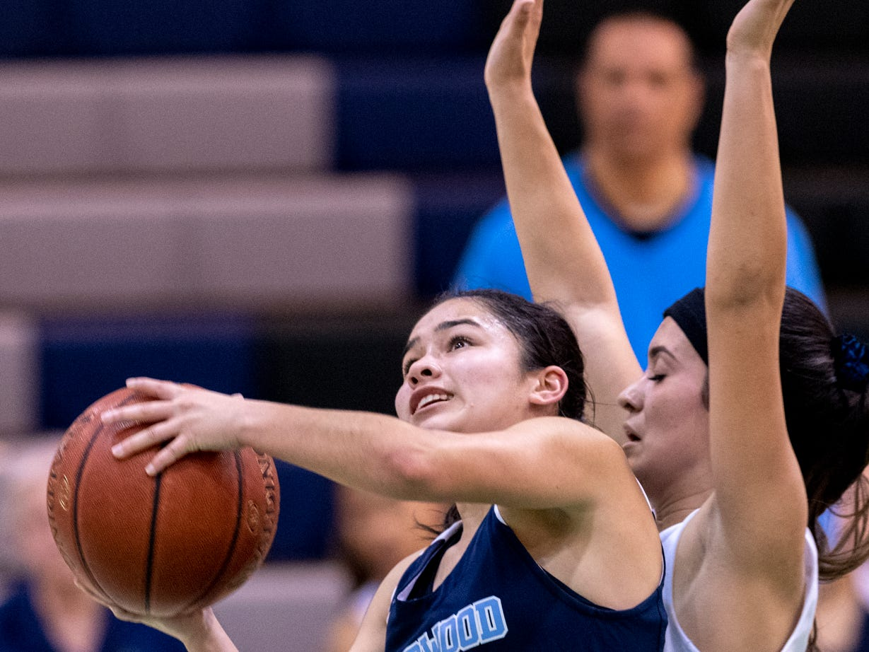 Redwood's Kalista Gamez shoots under pressure from El Diamante's Kyla Rios in a girls basketball game on Thursday, January 31, 2019.