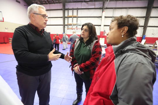 Richard Sena, left, speaks with Doris Suarez and Enid Karpeh prior to a joint comprehensive planning meeting at the Haverstraw Community Center in Haverstraw on Wednesday, Jan. 30, 2019.