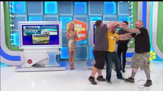 "Newark's Robert Jarrell is swarmed by his co-workers after winning ""The Price Is Right"" earlier this week."