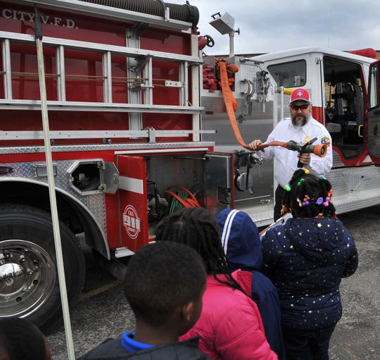 Booker T Washington Elementary students watched as Lakeside City Volunteer Fire Department, assistant fire chief, Lonnie Hare talked about some of the tools his department use to fight fires during the school's third-annual career day.
