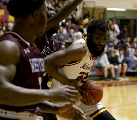 Midwestern State's Gilbert Thomas drives to the basket against West Texas A&M Thursday, Jan. 31, 2019, in D.L. Ligon Coliseum at MSUTexas.