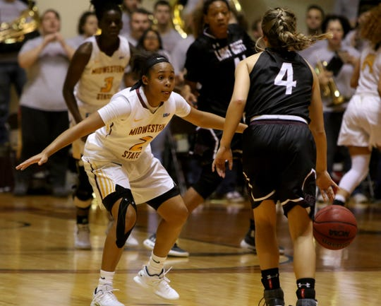 Midwestern State's Chelcie Kizart guards West Texas A&M's Lexy Hightower Thursday, Jan. 31, 2019, in D.L. Ligon Coliseum at MSU. The Mustangs upset the Lady Buffs 66-61.