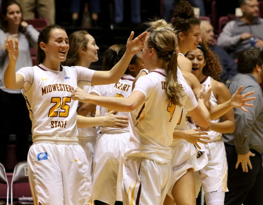 Midwestern State's Anni Scholl and Mica Schneider celebrate the Mustangs 66-61 win over West Texas A&M Thursday, Jan. 31, 2019, in D.L. Ligon Coliseum at MSU.