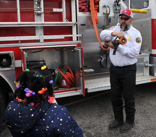 Booker T. Washington Elementary students watched as Lakeside City Volunteer Fire Department, assistant fire chief, Lonnie Hare talked about some of the tools his department use to fight fires during the school's third-annual career day.