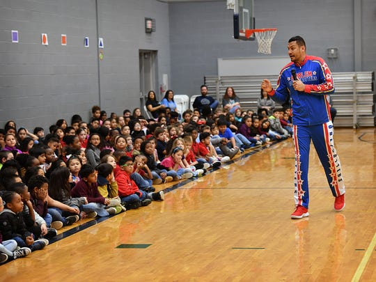 """Harlem Globetrotter Orlando """"El Gato"""" Melendez brought  some ball-handling skills, trick shots and an anti-bullying message to the kids at Scotland Park Elementary Friday morning."""