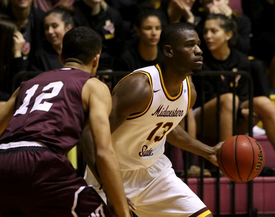 Midwestern State's D'monta Harris looks to pass in the game against West Texas A&M Thursday, Jan. 31, 2019, in D.L. Ligon Coliseum at MSUTexas.