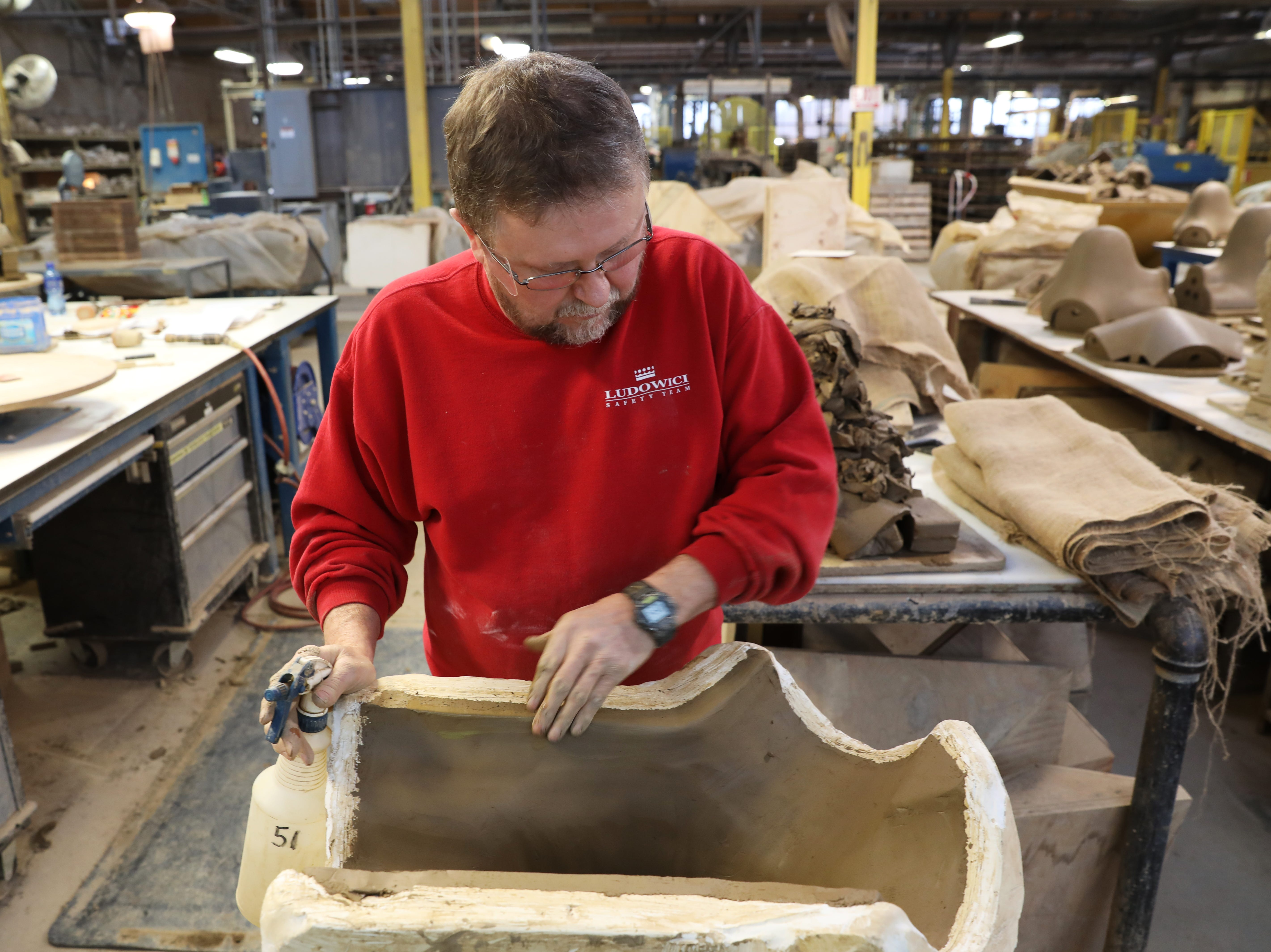 Mike Spencer works on a custom roof moulding at Ludowici Roof Tile Company. Spencer has been on the job at the New Lexington factory for 39 years.