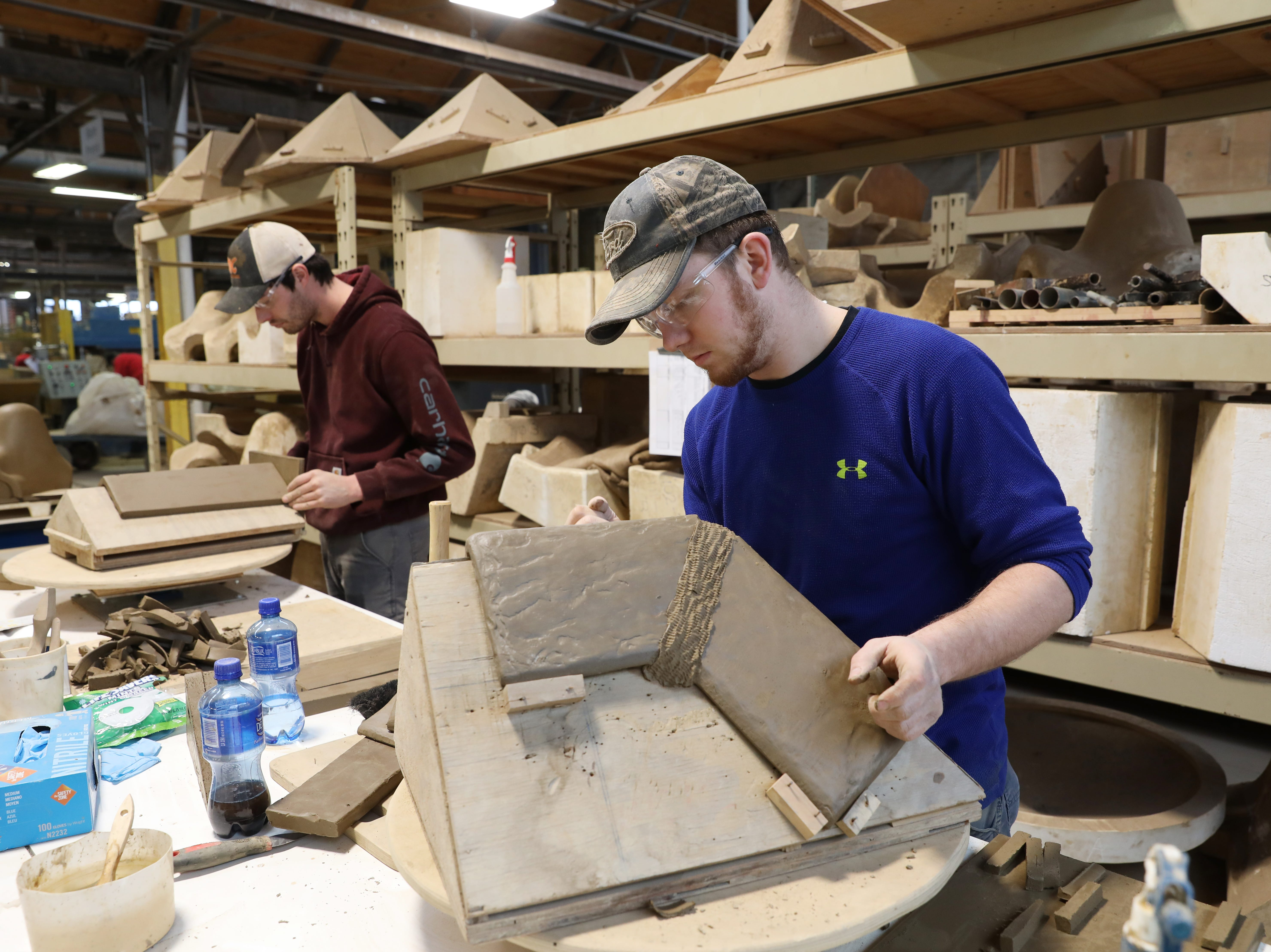 T.J. Abrams creates a custom roof moulding at Ludowici Roof Tile Company in New Lexington.