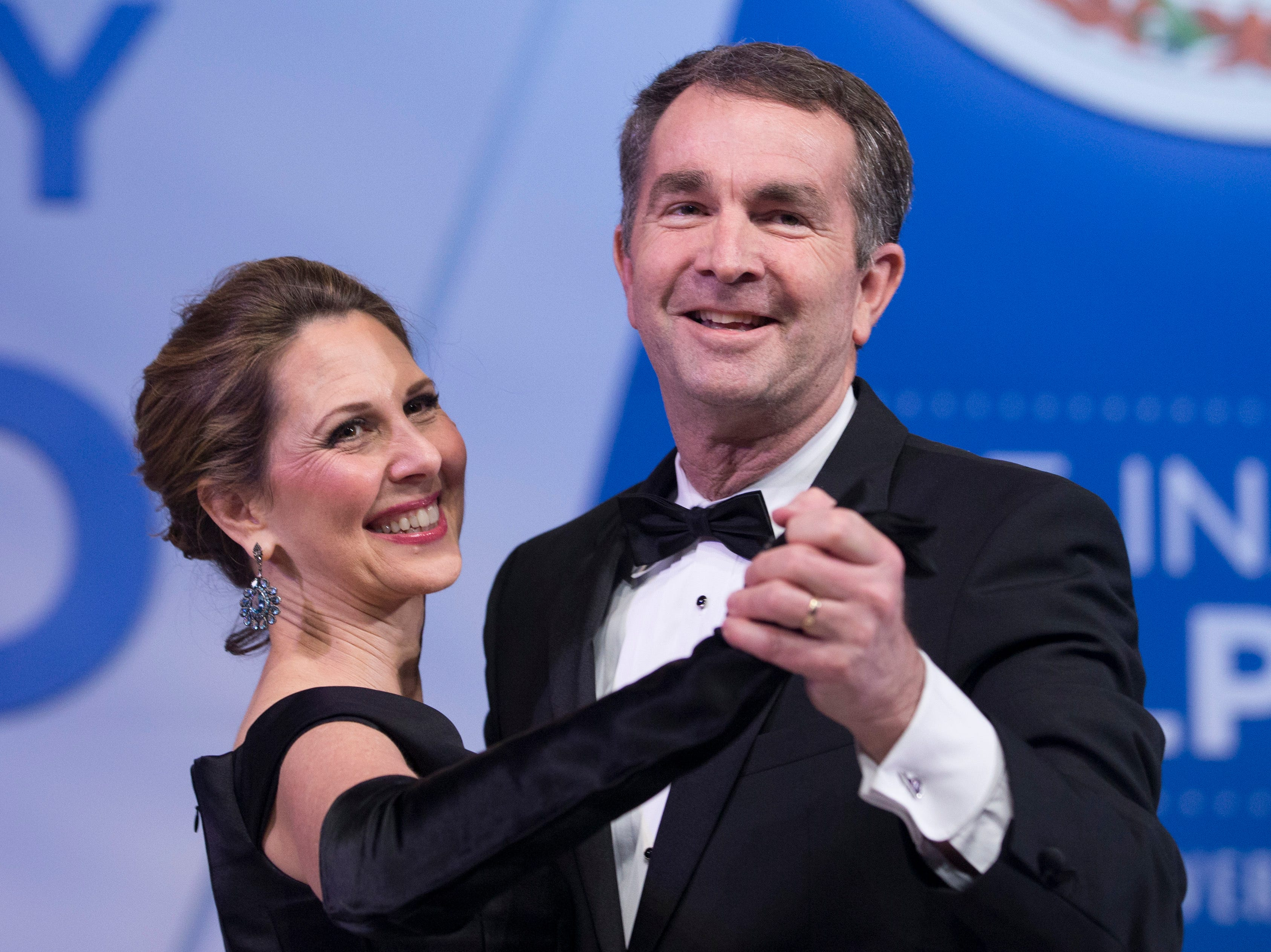 Virginia Governor Ralph Northam and his wife, Pam, dance at their inaugural ball in Richmond, Va., Saturday, Jan. 13, 2018.