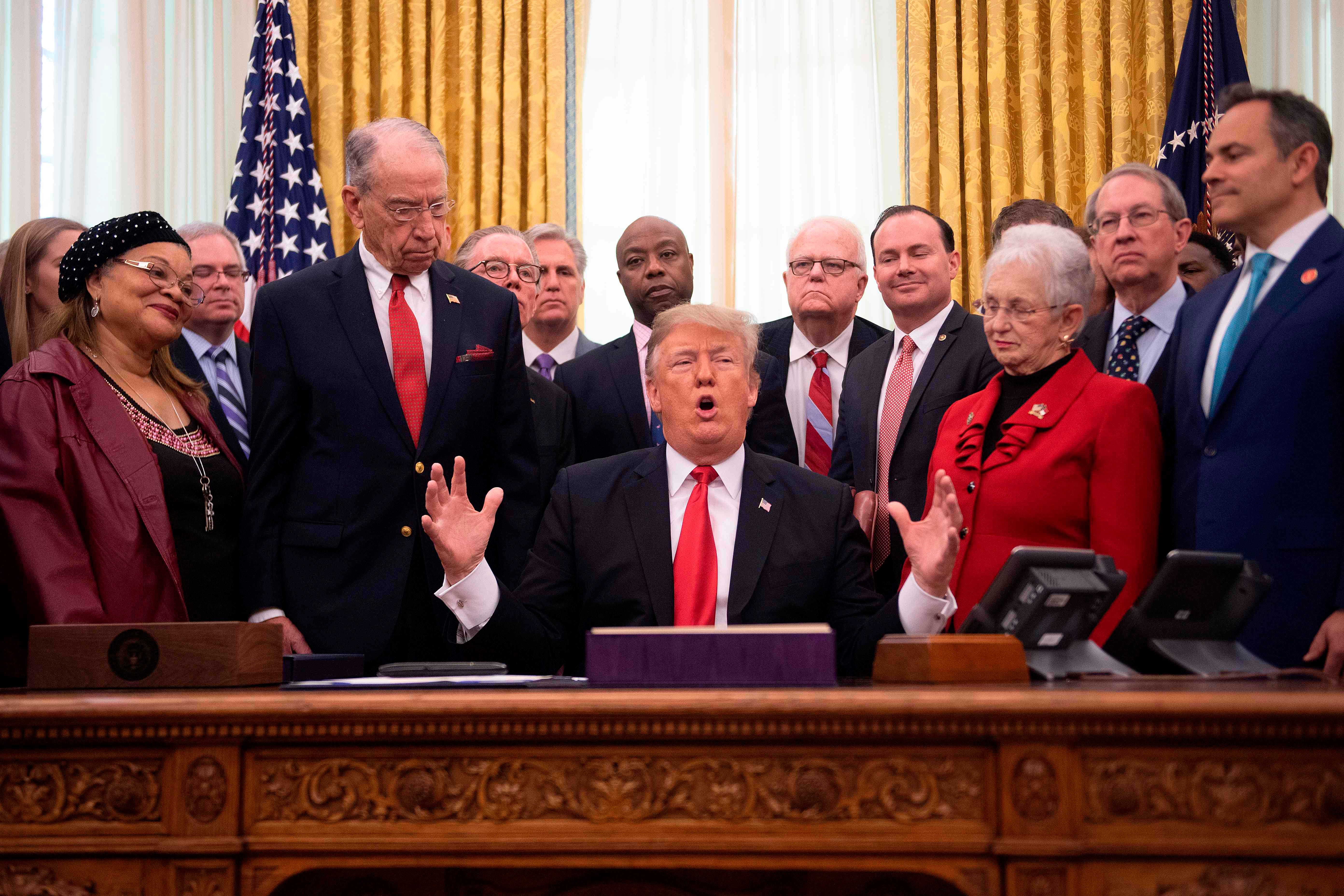 President Donald Trump speaks before signing the First Step Act and the Juvenile Justice Reform Act at the White House in Washington, DC, on December 21, 2018.