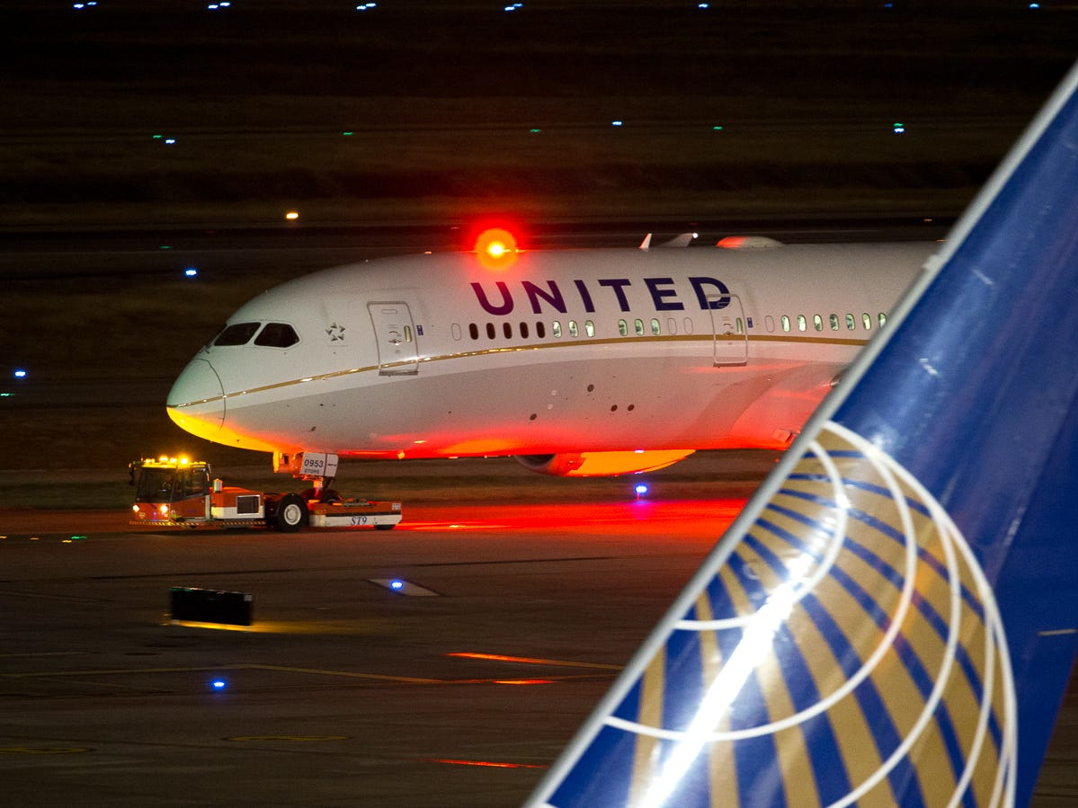 A United Airlines Boeing 787-9 is towed to its gate at George Bush Intercontinental Airport in Houston on Jan. 26, 2019.